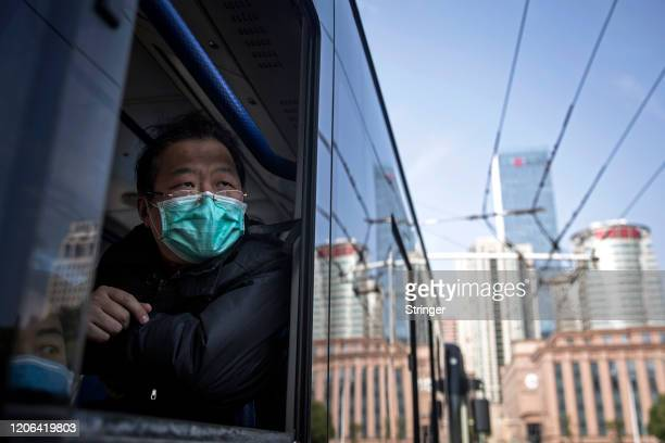 Discharged COVID-19 patient departs Wuchang Fang Cang makeshift hospital by bus, which is the latest temporary hospital being shut down, on March 10,...