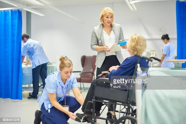 discharging the patient - sturti stock pictures, royalty-free photos & images