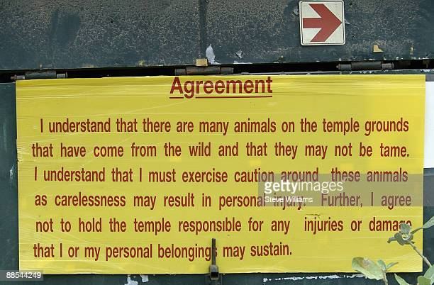 A disclaimer is displayed at the Wat Pa Luangta Bua Yanasampanno Forest Monastery on July 8 2008 in Kanchanaburi Thailand More commonly known as the...