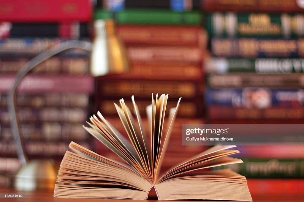 Disclosed book on table at library : Stock Photo