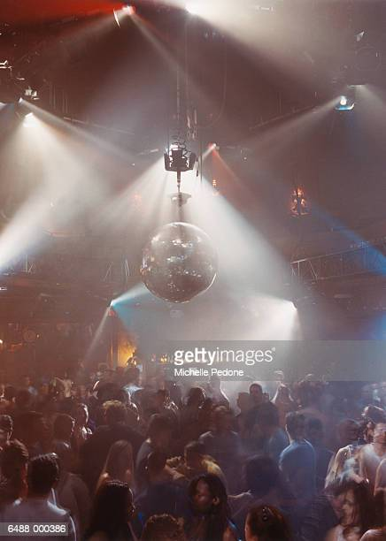 Disco Ball Above Dancing Crowd