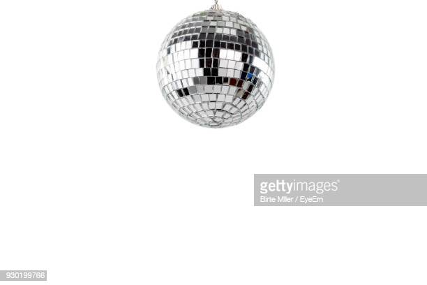 disco ball against white background - disco ball stock photos and pictures