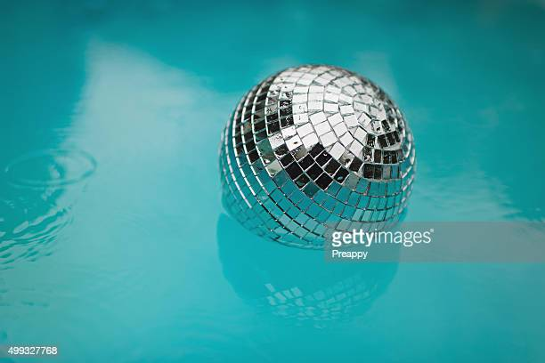 Disco ball floating in pool