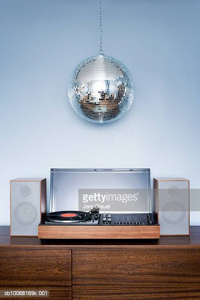 disco ball hanging over 1970?s stereo system - disco ball stock photos and pictures