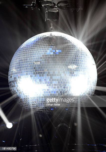 A disco ball hangs from the ceiling during a performance by singer Adam Lambert and guitarist Brian May of Queen during the iHeartRadio Music...