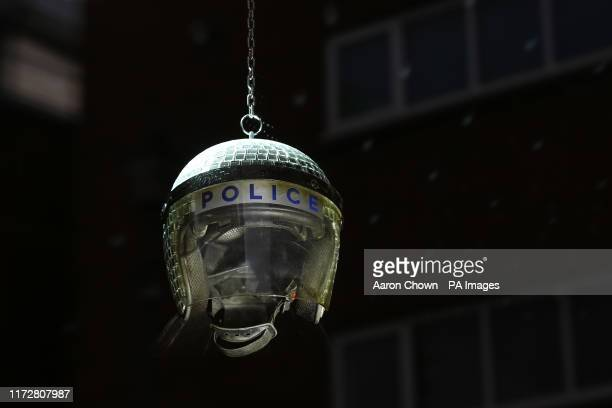 Disco ball police helmet in one of the departments in a homeware store, Gross Domestic Product, that is being launched in south London by the...