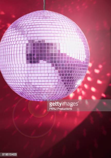 Disco ball shining on ceiling and walls