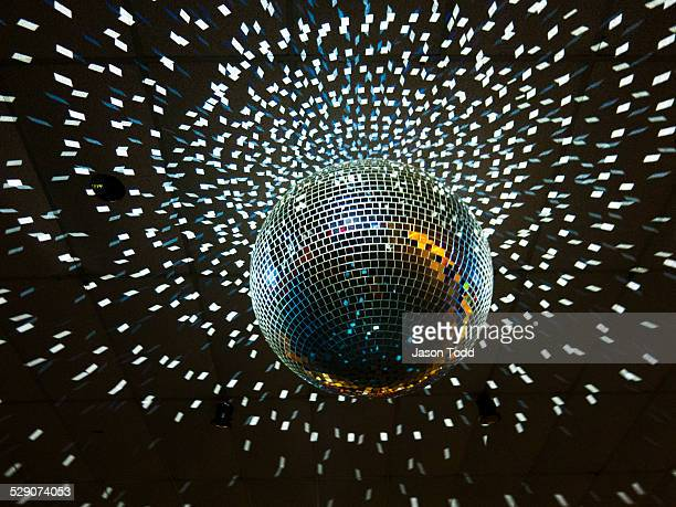 disco ball with lights hanging from ceiling - disco ball fotografías e imágenes de stock