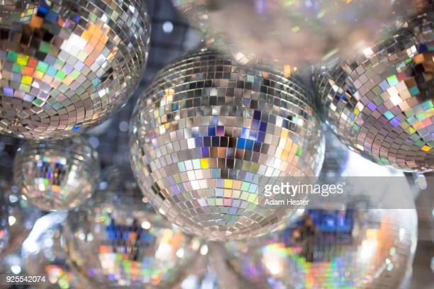 disco balls on ceiling - disco ball stock photos and pictures