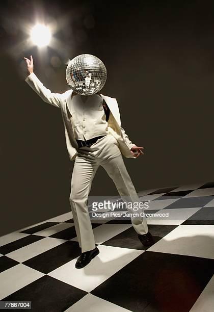Disco dancer with disco ball for head