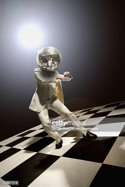 disco dancer with disco ball for head - dancing photos et images de collection