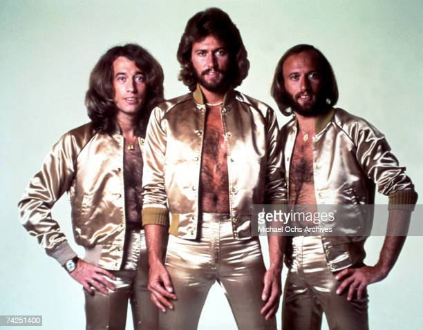 Disco group the Bee Gees pose for a portrait in gold lame outfits in 1977