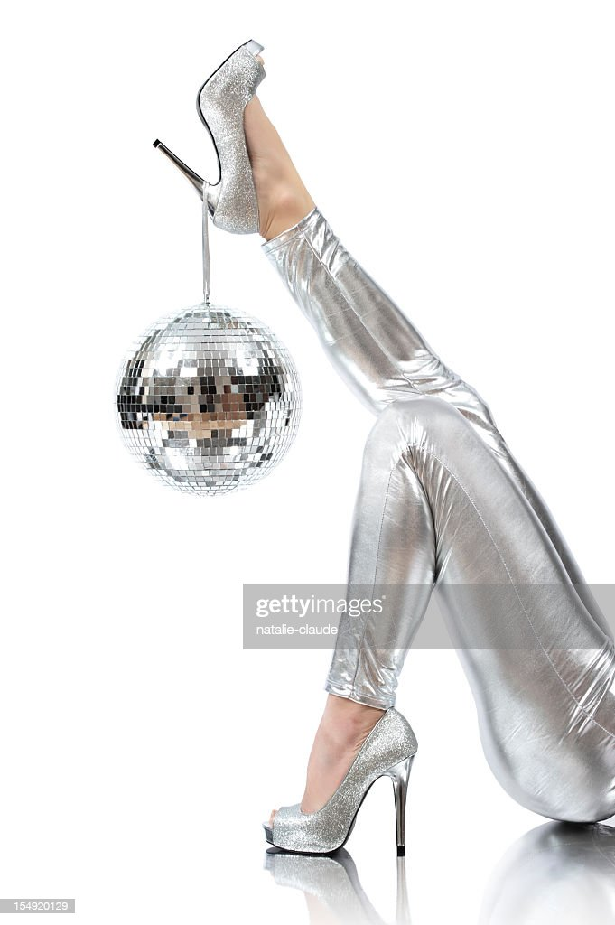 Disco time photo of disco ball hanging on silver high heels : Stock Photo