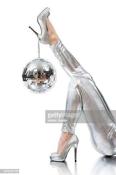 disco time photo of disco ball hanging on silver high heels - silver shoe stock pictures, royalty-free photos & images