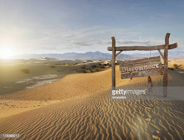 disconnect wooden sign in the desert