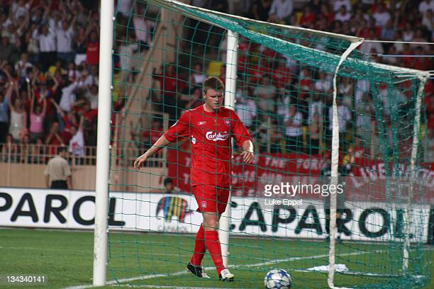 Disconsolate John Arne Riise goes to pick the ball up out of the back of the net after Liverpool go a goal down in the UEFA Super Cup at the Stade...
