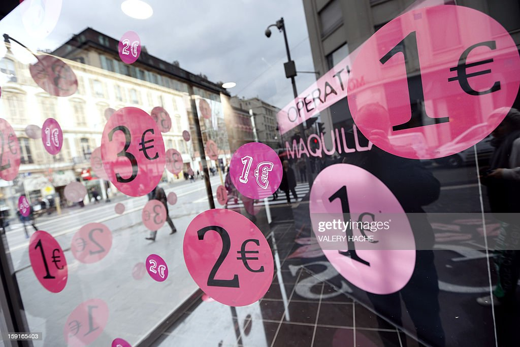 Discount stickers are placed on windows at a store during winter sales, on January 9, 2013, in Nice, southeastern France.