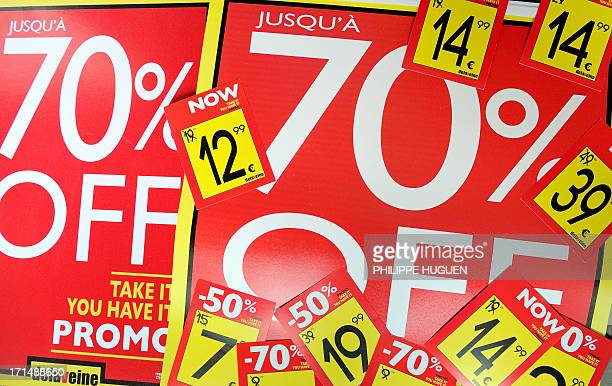 Discount tags are prepared in a store on June 25 2013 in Lille a day before the start of the summer sales in France AFP PHOTO PHILIPPE HUGUEN