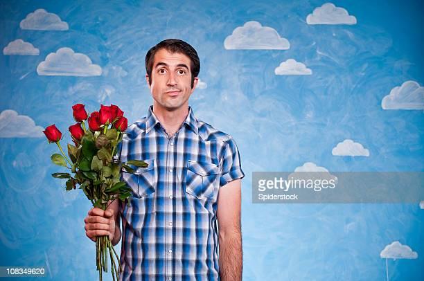 Entmutigt Nerd mit Rosen