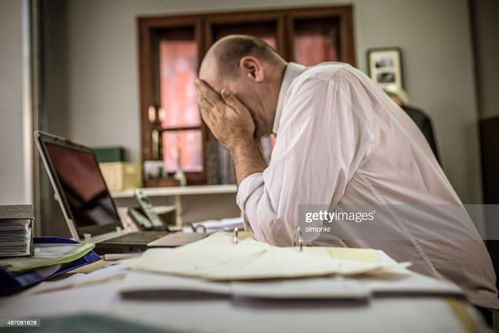 Discouraged office worker : Stock Photo