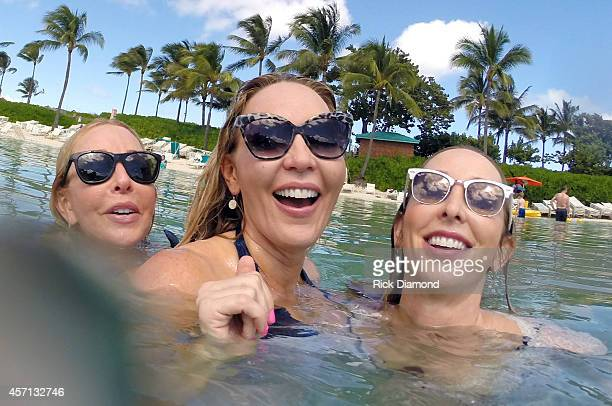Discovering Lucy Angel filming and portrait session L/R Kate Anderton Lindsay Anderton and Emily Anderton at Atlantis Paradise Island on October 12...