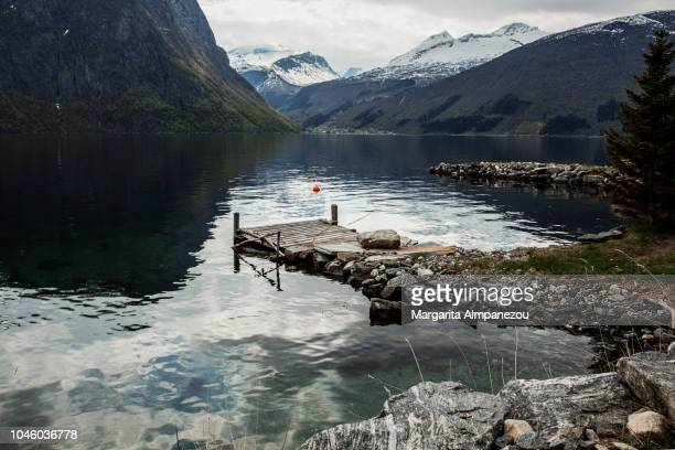 Discovering Norway: Nature, water, rocks, snowcapped mountains, fjords and a wooden platform