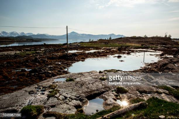 Discovering Norway: Sun reflecting on natural water pools