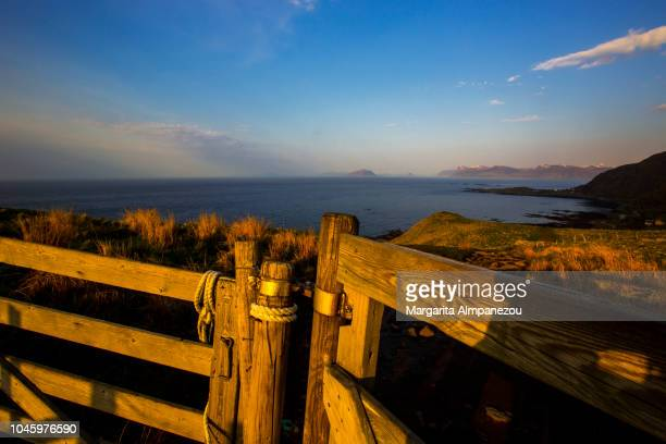 Discovering Norway: wooden fence with a view to the sea