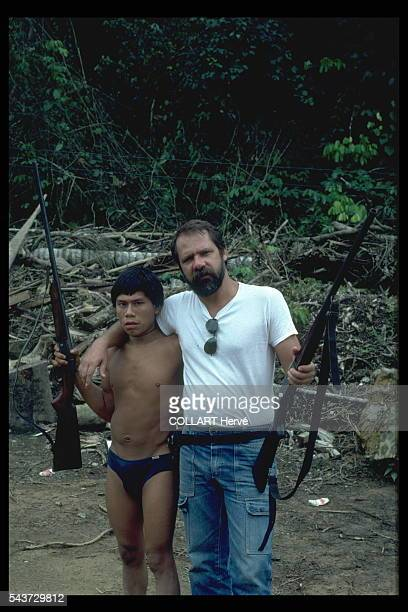Discovering the power of the gun this Yanomami begins an acculturation process triggered by illicit gold miners and at term the whole tribe is likely...