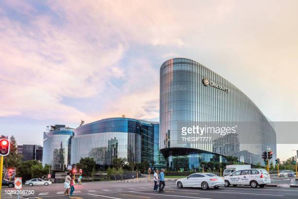 discovery building in sandton city at sunset - sandton stock pictures, royalty-free photos & images