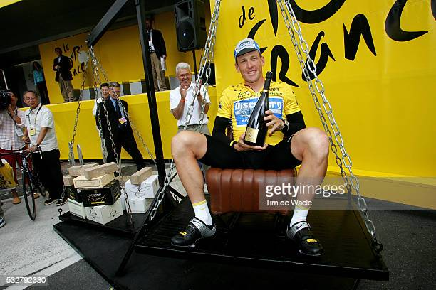 Discovery Channel team rider Lance Armstrong of the U.S. Is balanced on a scale in his weight in champagne prior to the start of the 199km sixth...
