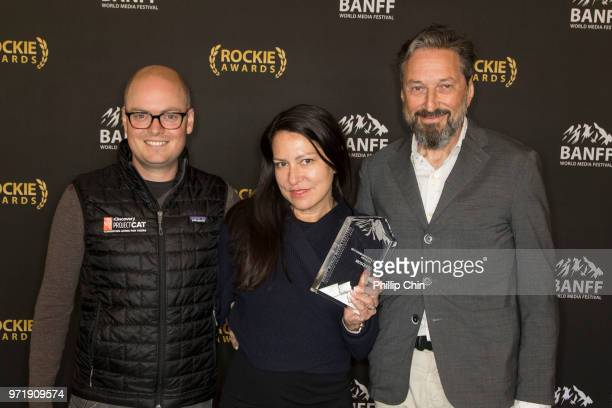 Discovery Channel Vice President Documentaries and Specials Jon Bardin Yap Films Executive Producer Elizabeth Trojian and Director Elliot Halpern win...