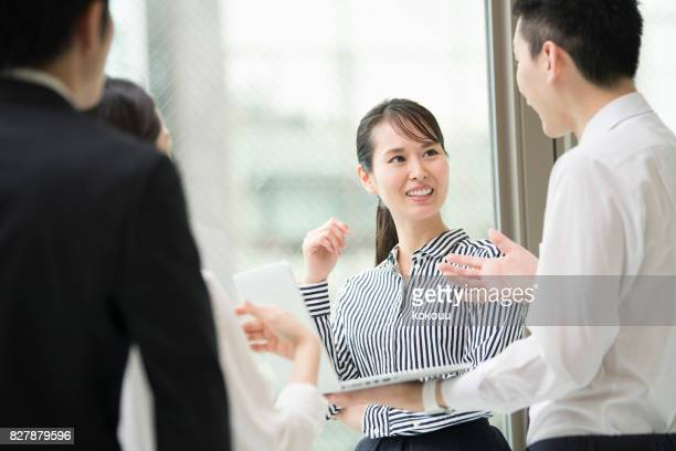 discuss with a smile. - east asia stock pictures, royalty-free photos & images