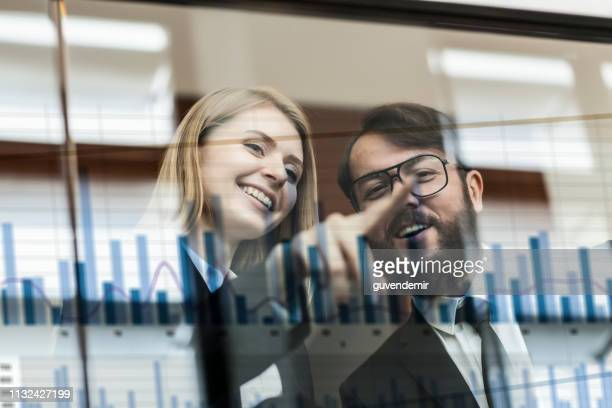 discussing business benefits on futuristic display - big data white stock pictures, royalty-free photos & images