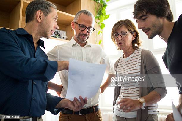 discussing business in a stand up meeting - comedian stock pictures, royalty-free photos & images