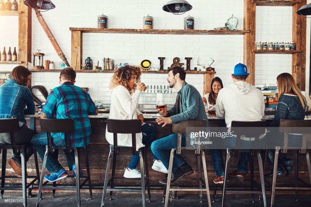 Discussing different types of beer : Stock Photo