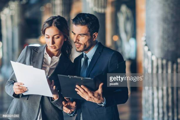 discussing important documentation - employment law stock photos and pictures