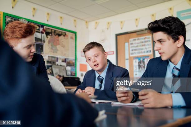 discussing in class - school children stock photos and pictures