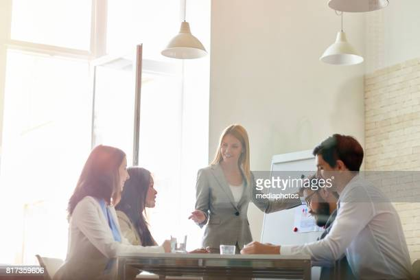 discussing project with colleagues - presenter stock photos and pictures