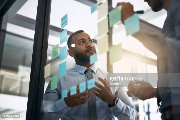discussing some new ideas - business strategy stock photos and pictures