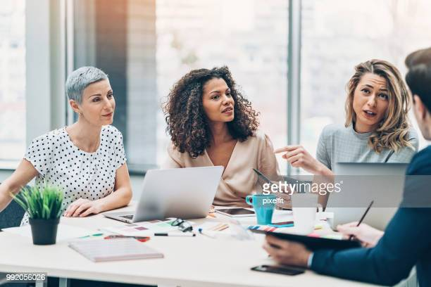 discussing the new strategy - responsibility stock pictures, royalty-free photos & images