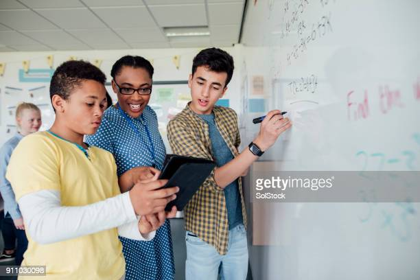 discussing the solution - classroom stock photos and pictures