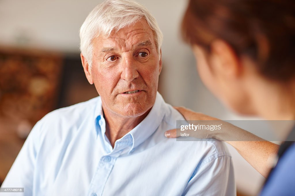 Discussing the way forward with her patient : Stock Photo