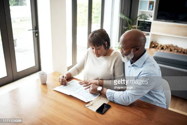 discussing what's necessary and what's a luxury - retirement stock pictures, royalty-free photos & images