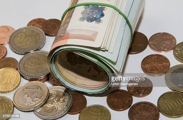 Discussion about cash Do we really need banknotes and coins Our picture shows Euro coins and a bundle of Euro banknotes