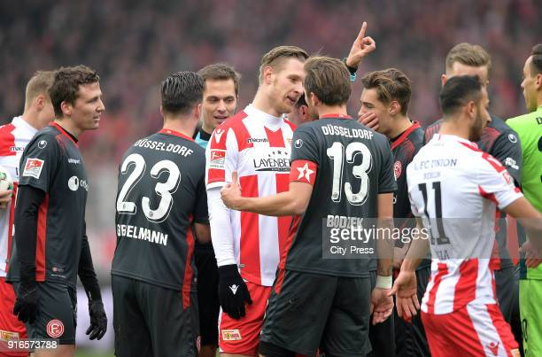 discussion between Sebastian Polter of 1FC Union Berlin and Adam Bodzek of Fortuna Duesseldorf during the second Bundesliga game between Union Berlin...