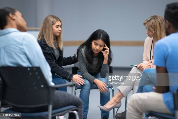 a discussion during a group therapy session about mental health and addictions stock photo - alcoholics anonymous stock pictures, royalty-free photos & images