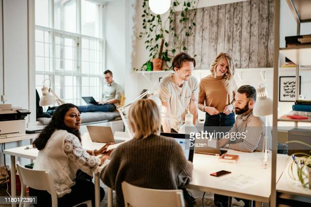 discussion in start-up company between multi-ethnic employees - employee engagement stock pictures, royalty-free photos & images