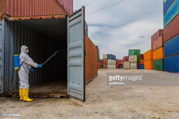 disease control service staff disinfect cargo to prevent spread covid-19 - biochemical weapon stock pictures, royalty-free photos & images