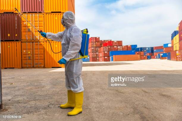 disease control service staff disinfect cargo to prevent spread covid-19 - infectious disease stock pictures, royalty-free photos & images